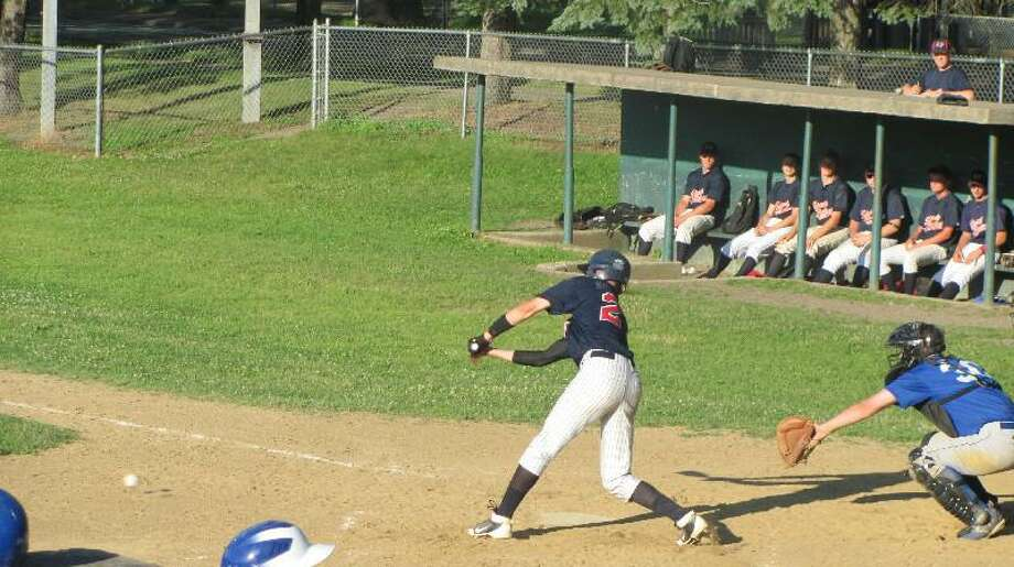 JOHN NESTOR/Register Citizen Correspondent Torrington's Cody Lemieux laid down a pair of perfect bunts to drive in two runs in Thursday's 17-7 win over Winsted at Walker Field.