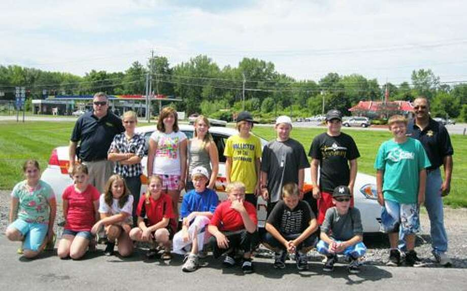 Photo Courtesy MADISON COUNTY SHERIFF'S DEPARTMENT Kids and their families prepare for Sheriff's Summer Camp.