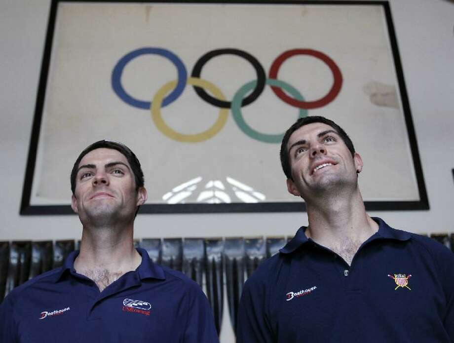 Associated Press American Olympic rowers Ross James, left, and his twin brother, Grant James, right, pose next to an Olympic flag at the rowing office in Oakland, Calif. Both will be competing in the London Olympics.