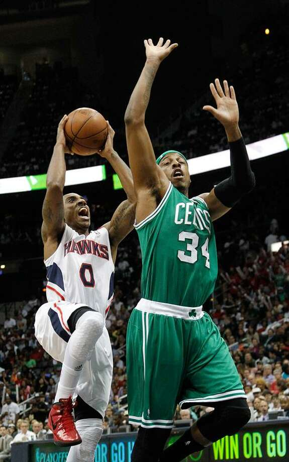 Atlanta Hawks guard Jeff Teague (0) drives to the basket as Boston Celtics forward Paul Pierce (34) defends during the first half of Game 5 of an NBA first-round playoff series basketball game Tuesday, May 8, 2012, in Atlanta. (AP Photo/John Bazemore) Photo: AP / AP2012
