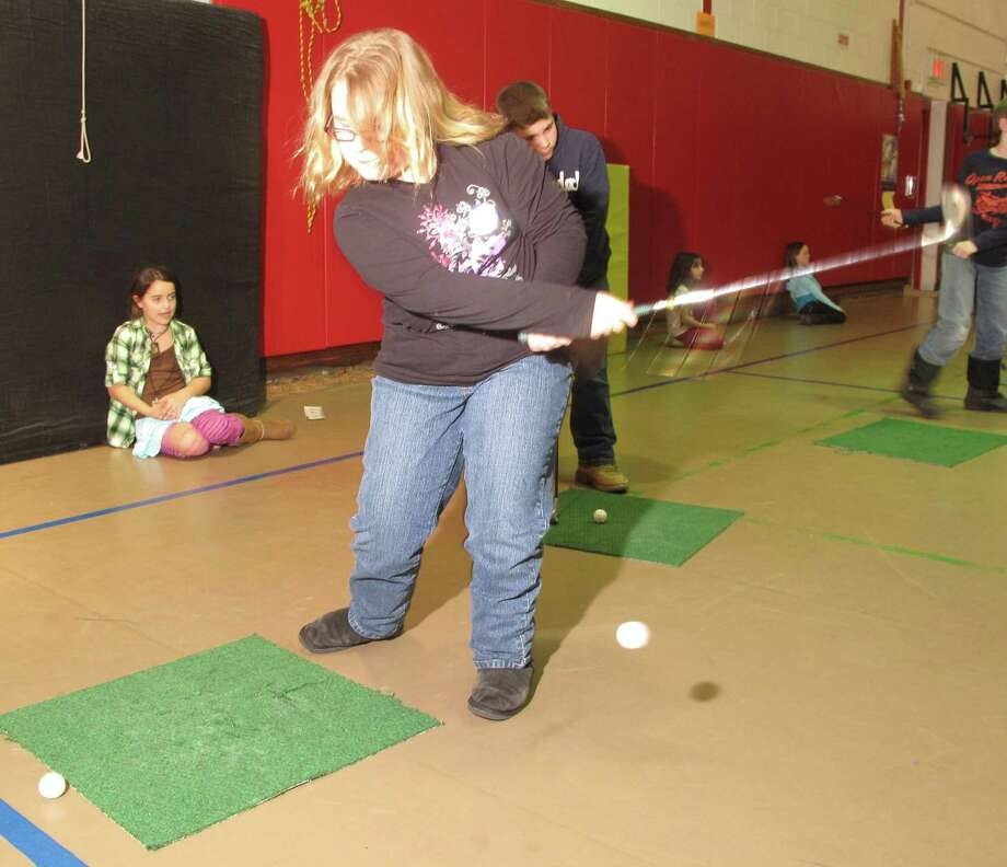 "Dispatch Staff Photo by JOHN HAEGER <a href=""http://twitter.com/oneidaphoto"">twitter.com/oneidaphoto</a> Bethany Conway ,10, works on her short game on  Tuesday, March 6, 2012 in at McAllister Elementary School in Sherrill."