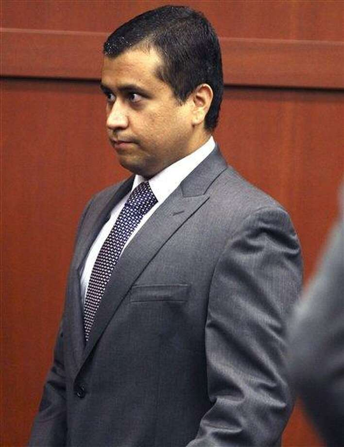 FILE -In this Friday, June 29, 2012 file photo, George Zimmerman enters the courtroom before he appears before Circuit Judge Kenneth R. Lester, Jr., during a bond hearing at the Seminole County Criminal Justice Center in Sanford, Fla. Zimmerman, a neighborhood watch leader was released from jail Friday, July 6, 2012, for a second time while he awaits his second-degree murder trial for fatally shooting Trayvon Martin. (AP Photo/Orlando Sentinel, Joe Burbank, Pool, File) Photo: AP / Pool Orlando Sentinel