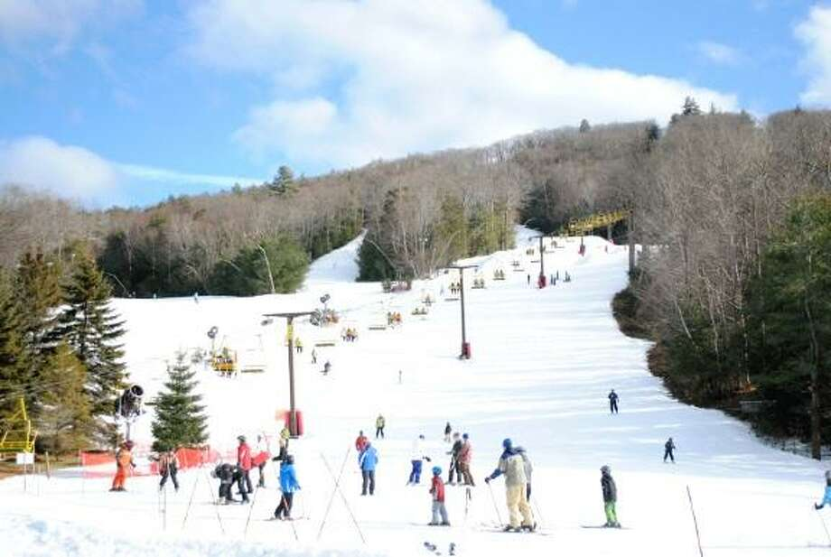 MIKE AGOGLIATI/ Register Citizen  Large crowds flocked to Ski Sundown in New Hartford to enjoy a day of skiing Sunday. The mountain is enjoying a good year owner Bob Switzgable said, despite having to make all of its snow.