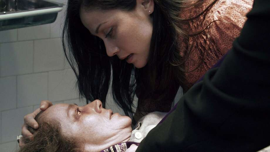 """In this film image released by Paramount Pictures, Suzan Crowley plays Maria, left, and Fernanda Andrade plays Isabella Rossi in a scene from """"The Devil Inside."""" (AP Photo/Paramount Pictures) Photo: ASSOCIATED PRESS / AP2012"""
