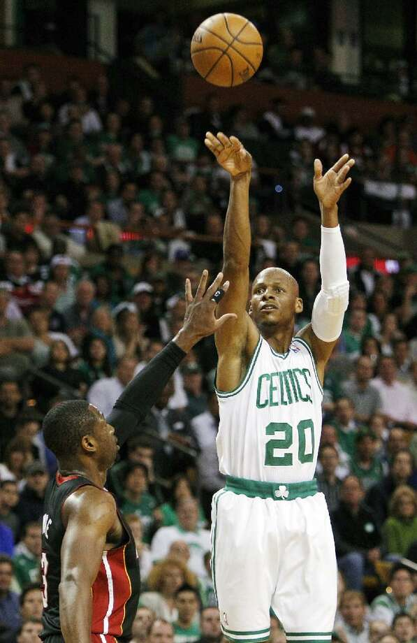 ASSOCIATED PRESS Boston Celtics guard Ray Allen (20) shoots a three-point basket over Miami Heat guard Dwyane Wade (3) during the first quarter of Game 4 in their NBA Eastern Conference finals series in Boston on June 3. Allen told the Heat on Friday that he has decided to leave the Celtics and join up with the reigning NBA champions.