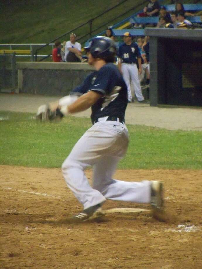 PETER WALLACE/Register Citizen Holy Cross High School graduate Kyle Murphy was 3-for-4 with a homer and 4 RBI in the Titans' 7-3 breakout game Friday night at Fuessenich Park against the Wachusett Dirt Dawgs.