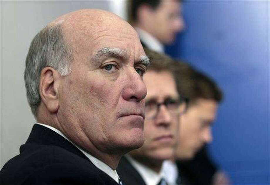 FILE - In this Dec. 8, 2011 file photo, White House Chief of Staff William Daley, left, and White House Press Secretary Jay Carney, second from left, listen during President Barack Obama's news conference in the White House briefing room in Washington. Administration officials say Daley resigning as White House chief of staff. (AP Photo/Carolyn Kaster, File) Photo: AP / AP