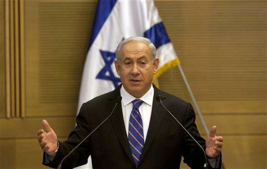 Israel's Prime Minister Benjamin Netanyahu gestures during a joint press conference with Kadima party leader Shaul Mofaz, unseen, announcing the new coalition government in Jerusalem Tuesday. Associated Press Photo: AP / AP