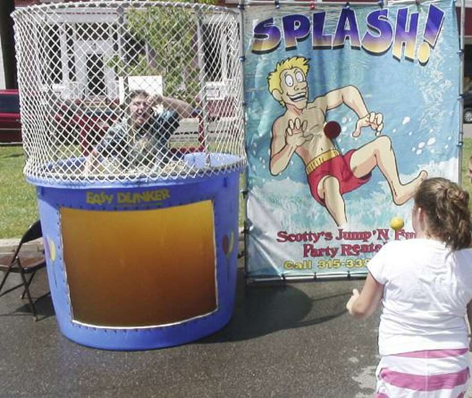 Dispatch Staff Photo by JOHN HAEGER (Twitter.com/OneidaPhoto) Jaden Green, then-9, of Oneida, sends Elliott Clark into the dunking booth during Summer Fest in 2010. This year's Summer Fest is July 14.