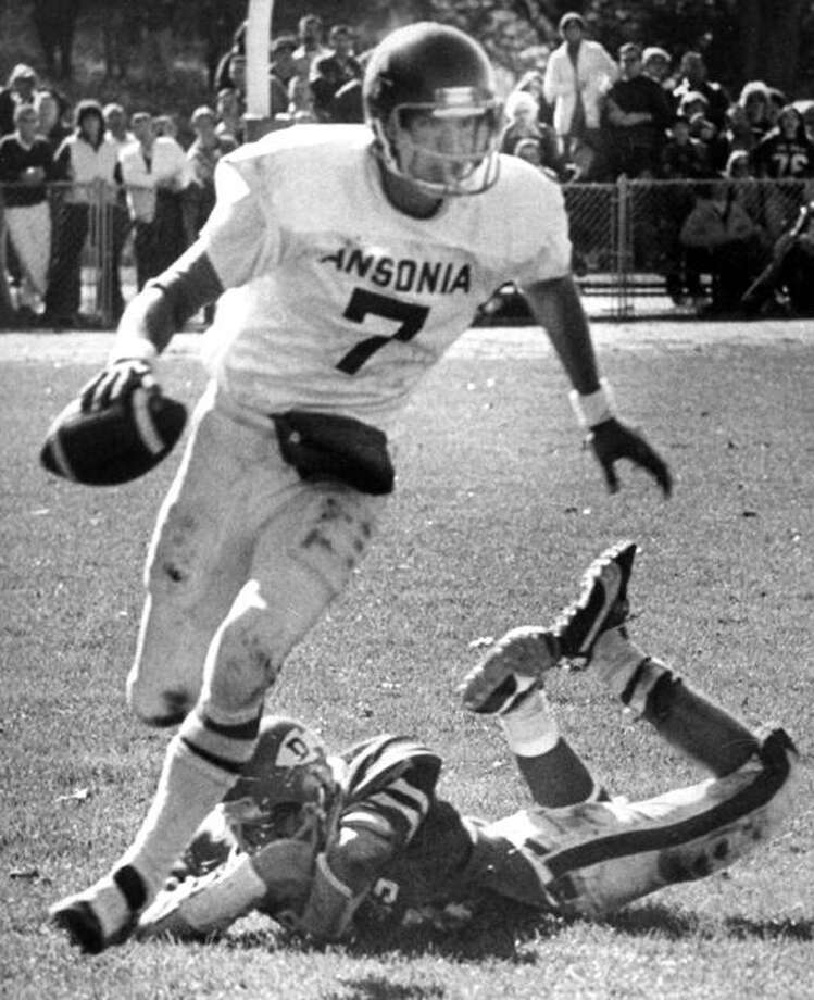 Legendary Ansonia quarterback Sandy Osiecki and the Chargers fell to Amity in the 1978 Class LL state championship game. The loss snapped Ansonia's 36-game winning streak. (Register file photo)