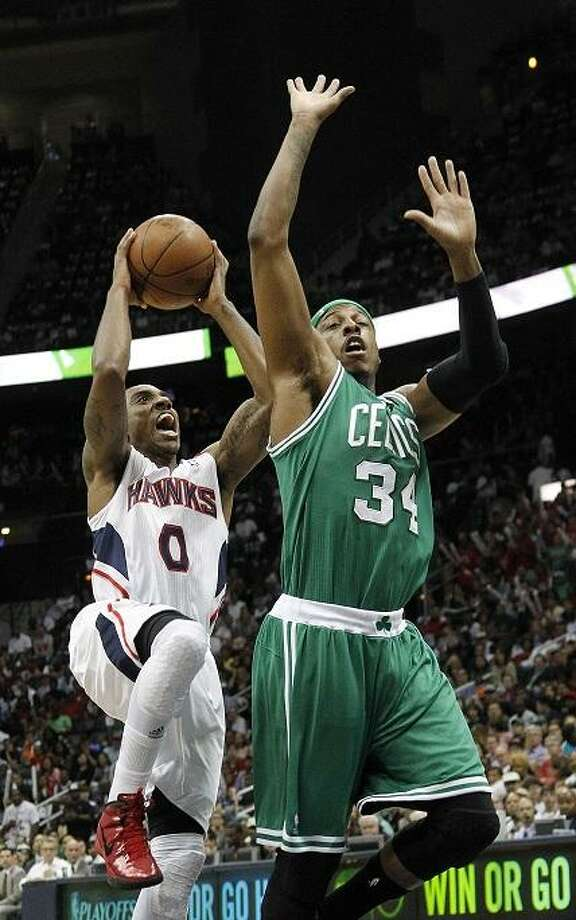 Atlanta Hawks guard Jeff Teague (0) drives to the basket as Boston Celtics forward Paul Pierce (34) defends during the first half of Game 5 of an NBA first-round playoff series basketball game Tuesday, May 8, 2012, in Atlanta. (AP Photo/John Bazemore) Photo: ASSOCIATED PRESS / AP2012