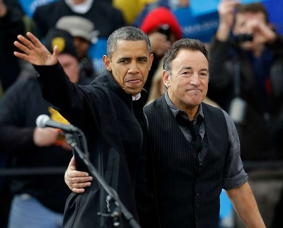 President Barack Obama, accompanied by singer Bruce Springsteen, waves as he arrive at a campaign event near the State Capitol Building in Madison, Wis., Monday, Nov. 5, 2012. (AP Photo/Pablo Martinez Monsivais) Photo: ASSOCIATED PRESS / AP2012