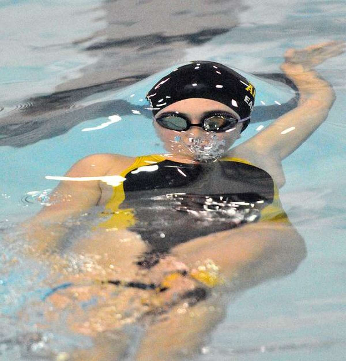 Amity's Shannon Earley on the backstroke leg of the 200 Medley Relay. Peter Casolino/New Haven Register.