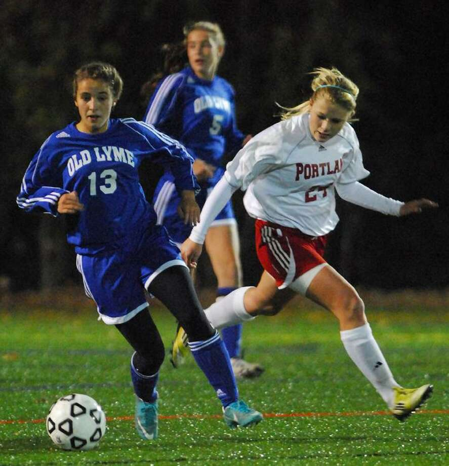 Catherine Avalone/The Middletown PressPortland junior forward McKenzie Reimondo defends Lyme-Old Lyme sophomore Meridith Aird in the first half of the Shoreline Championship. Portland defeated LOL 2-1 at Indian River Athletic Complex in Clinton Monday night.