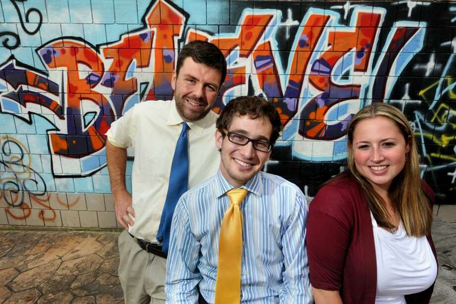 Teachers Wayne Austin, Matt Presser and Desiree Bisaillon, who attended a program presented by the National Academy of Teacher Education, pose at High School in the Community Thursday. VM Williams/Register
