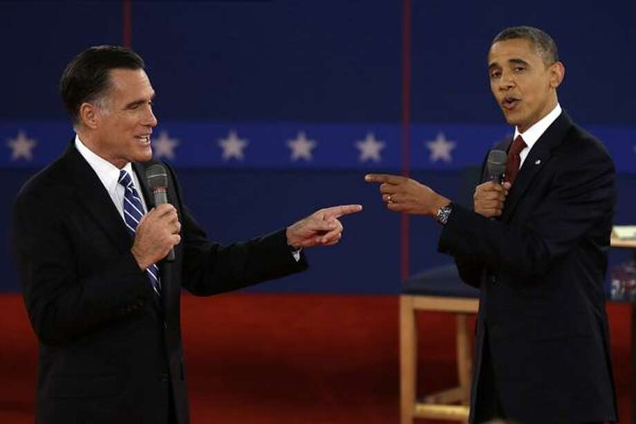 In this Oct. 16, 2012 file photo, Republican presidential candidate, former Massachusetts Gov. Mitt Romney and President Barack Obama spar during the second presidential debate at Hofstra University in Hempstead, N.Y. (AP Photo/Charlie Neibergall, File) Photo: ASSOCIATED PRESS / A2012