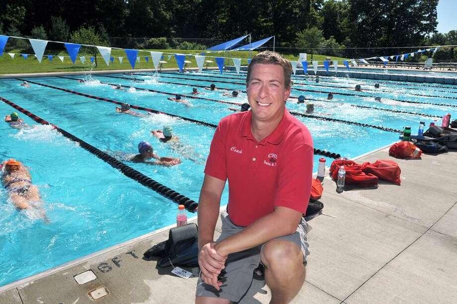 Cheshire-- New Cheshire high swimming coach Dan Mascolo.  Peter Casolino/New Haven Register 8/29/12