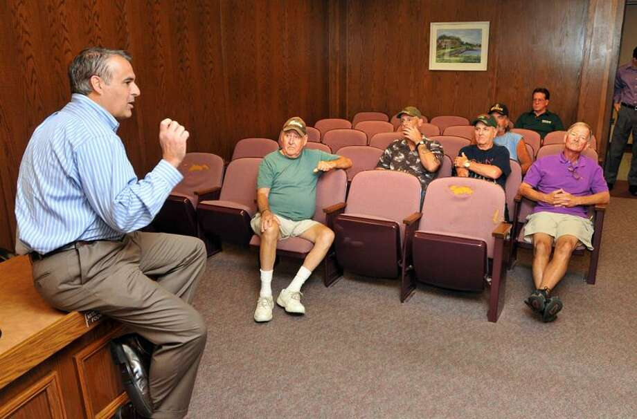 West Haven mayor John M. Picard talks with fishermen concerning the right to use the piers at night during a meeting at City Hall Thursday afternoon. Peter Casolino/New Haven Register