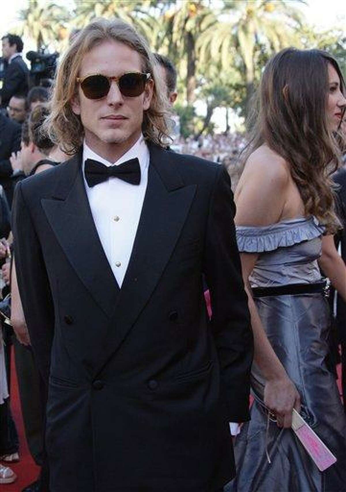 """In this file photo, Andrea Casiraghi, left, son of Princess Caroline of Hanover, and Tatiana Santo Domingo arrive for the screening of the film """"Marie-Antoinette,"""" at the 59th International film festival in Cannes, southern France. The Monaco palace announced Wednesday the engagement of Casiraghi to Santo Domingo. Associated Press"""