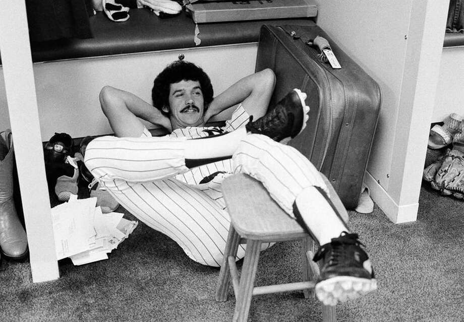 New York Yankees pitcher Ron Guidry and his method of relaxing in the clubhouse on Sept. 28, 1977 in New York. Guidry spent the 1974 season with the Double-A West Haven Yankees. (AP Photo/Harry Harris) Photo: AP / AP1977