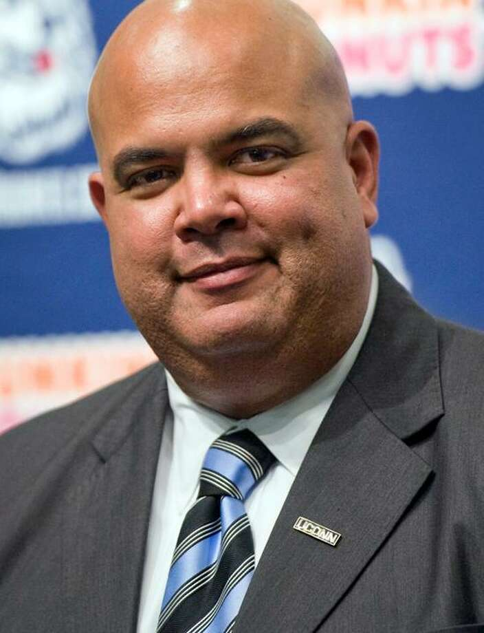Warde Manuel smiles during a news confernce announcing him as the new athletic director for the University of Connecticut in Storrs, Conn., Monday, Feb. 13, 2012.   (AP Photo/Jessica Hill) Photo: AP / AP2012