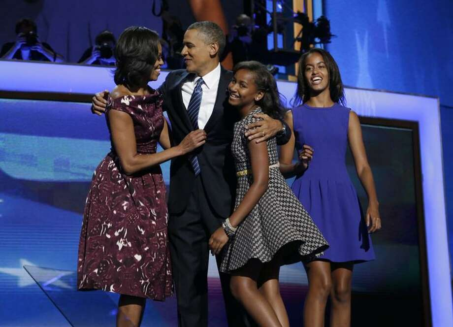 President Barack Obama, left, is joined on stage by first lady Michelle Obama, left, their children Sasha and Malia, right, on the final day of the Democratic National Convention in Charlotte, N.C., Thursday, Sept. 6, 2012.(AP Photo/Charles Dharapak) Photo: AP / AP