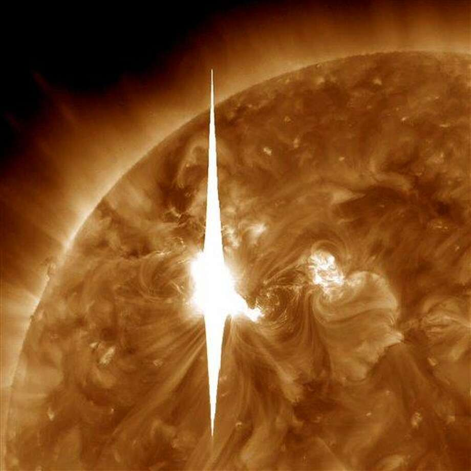 This handout image provided by NASA shows a solar flare erupting Tuesday. The flare is heading toward Earth and could disrupt power grids, GPS and airplane flights. Associated Press Photo: ASSOCIATED PRESS / AP2012