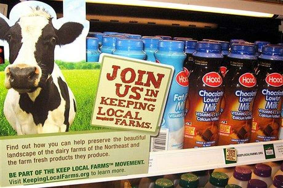 In this 2009 file photo released by the University of Vermont, milk is displayed with a Keep Local Farms sign in Burlington, Vt. The Keep Local Farms program, set up in 2009, a year of record low milk prices paid to farmers, urges colleges, universities and other institutions in New England to charge a little more for their milk, with the proceeds going to dairy farmers in the region. which has lost 66 percent of its dairy farms in 30 years due to low milk prices paid to farmers, and high feed, fuel and labor costs. Associated Press Photo: AP / University of Vermont