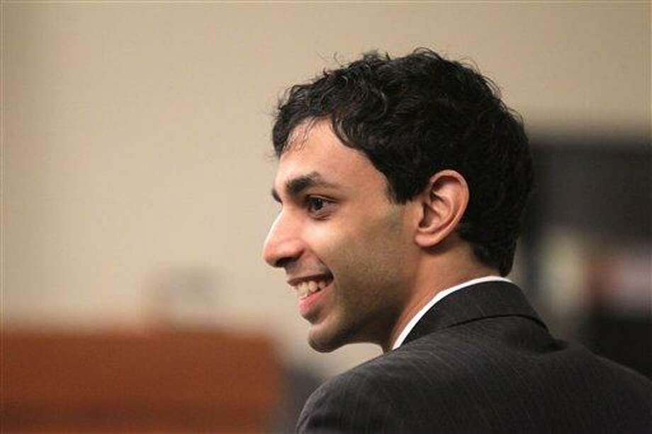 Dharun Ravi shares a laugh with his attorneys during a break in his trial Wednesday at the Middlesex County Courthouse in New Brunswick, N.J. Ravi,a former Rutgers University student, is accused of using a webcam to spy on his roommate, Tyler Clementi,  during an intimate encounter with another man. Days later  Clementi committed suicide.  Associated Press Photo: AP / Pool, The Star-Ledger