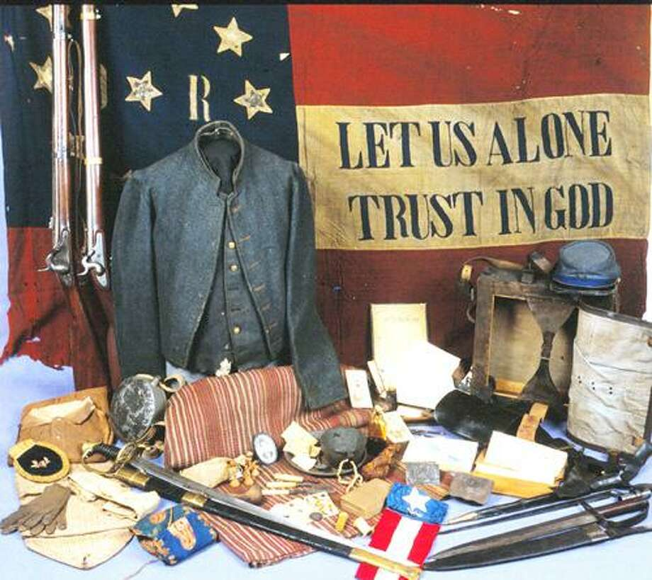 In this undated photo, infantry items appear on display at Louisiana's Civil War Museum in New Orleans. Battle flags line the walls. Uniforms, swords and long-barreled guns fill case after museum case, alongside homespun knapsacks, dented canteens and tiny framed pictures of women the soldiers left at home. In the back, where the body of Jefferson Davis once lay in state, the collection is dedicated to the onetime president of the Confederacy, complete with his top hat and fancy shoes. But 150 years after the Civil War, the little museum finds itself in another battle: like other Civil War museums, in both the north and the South, it is fighting to make the changes needed to keep it relevant to coming generations for which the war is not a memory. (AP Photo/Louisiana's Civil War Museum, Claude Levet) Photo: AP / Louisiana's Civil War Museum