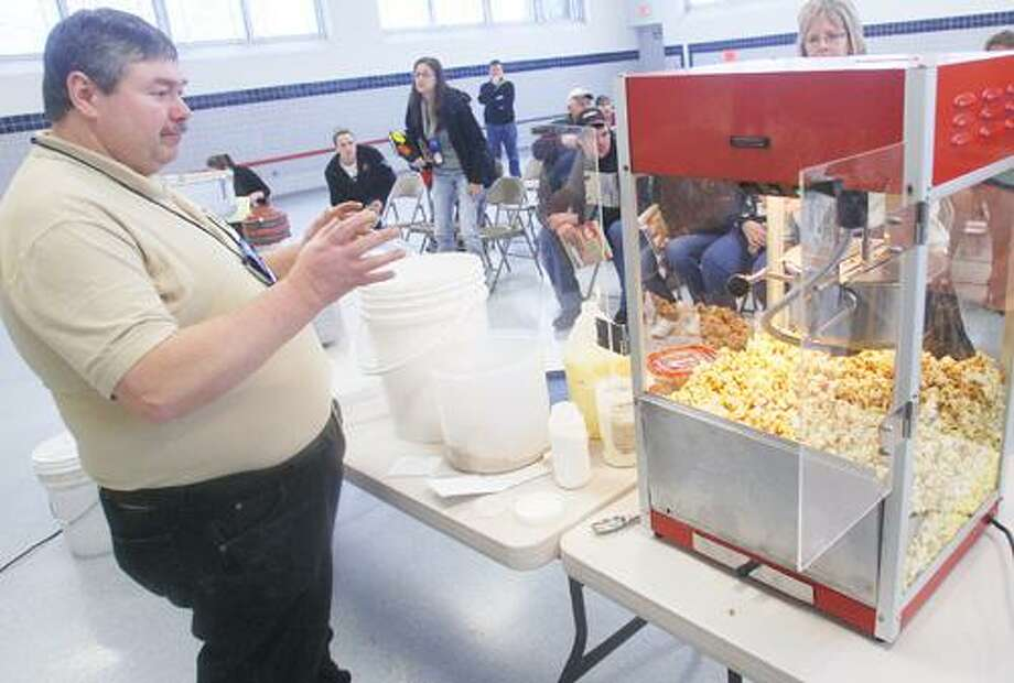 Photo by JOHN HAEGER (Twitter.com/OneidaPhoto)   Greg Zimpfer talks about making maple popcorn during a workshop at the annual Maple Conference held at VVS on Saturday Jan. 7, 2012.
