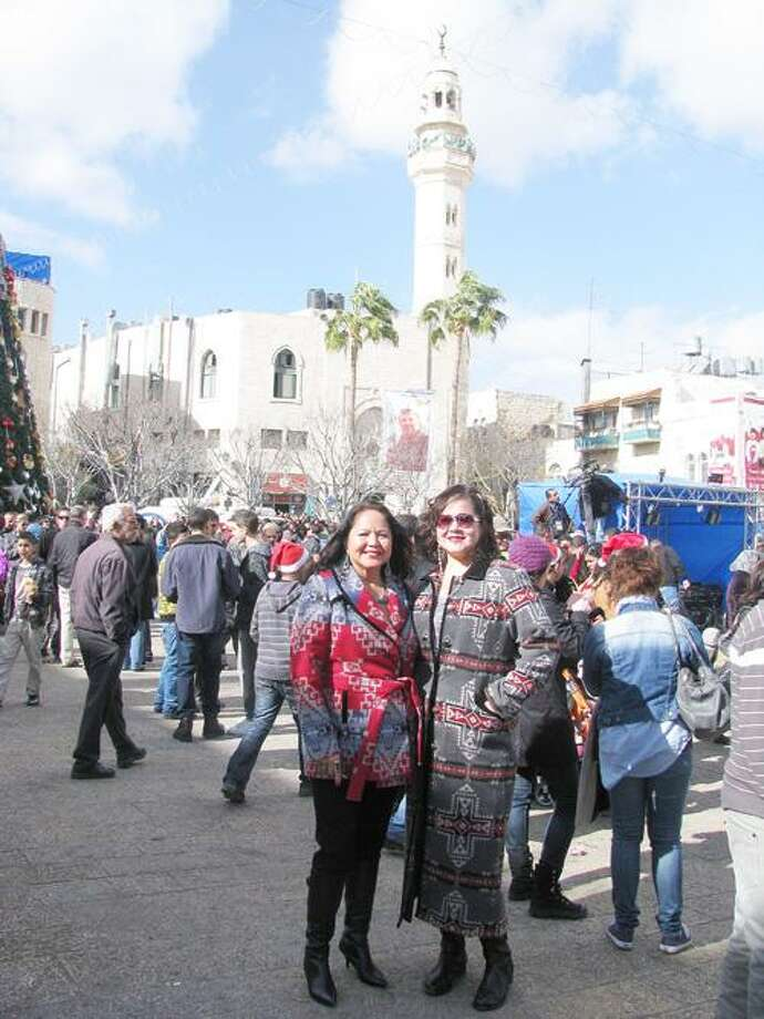Photo Courtesy Joanne Shenandoah Joanne and Leah Shenandoah in Manger Square, Bethlehem, Palestine on Dec. 24.