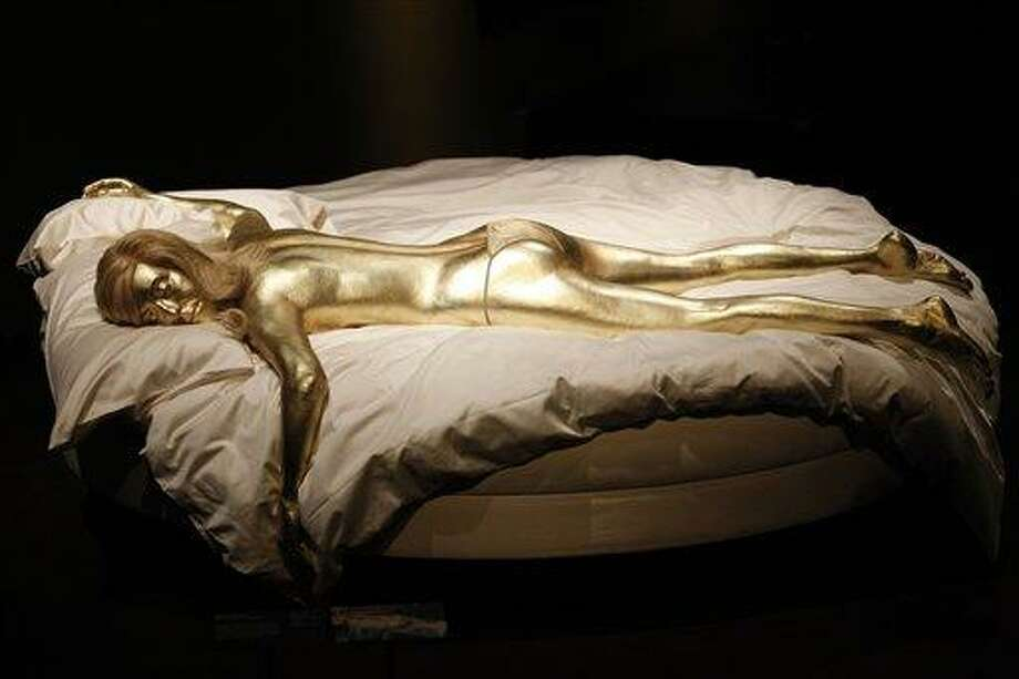 A recreation of Jill Masterson's golden body in the film 'Goldfinger' is seen on display in the exhibition 'Designing 007 - Fifty Years of Bond Style' at the Barbican centre in London, Thursday, July 5, 2012. (AP Photo/Sang Tan) Photo: AP / AP