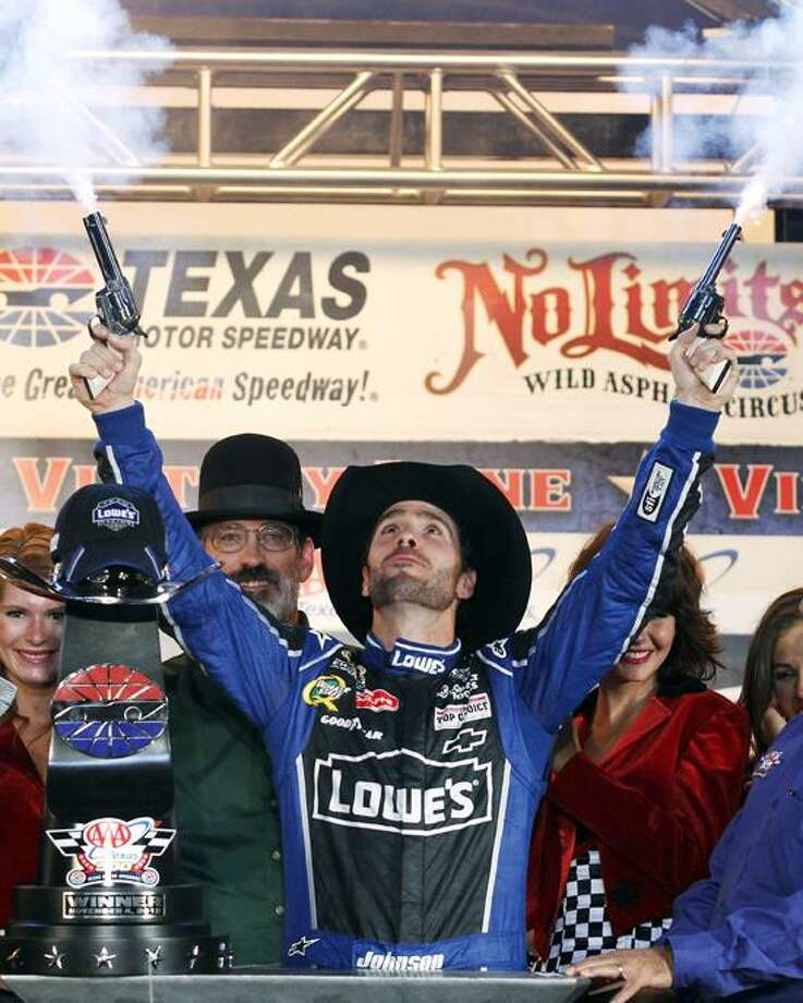 Jimmie Johnson fires blanks out of a revolver as he celebrates his win in victory lane following the NASCAR Sprint Cup Series auto race at Texas Motor Speedway, Sunday, Nov. 4, 2012, in Fort Worth, Texas. (AP Photo/Tim Sharp) Photo: AP / AP2012