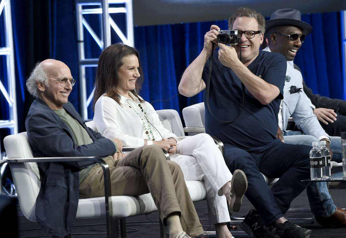 Actor/executive producer Jeff Garlin, second right, takes a photo as, from left, actor/creator/executive producer Larry David, Susie Essman and J.B. Smoove participate in the