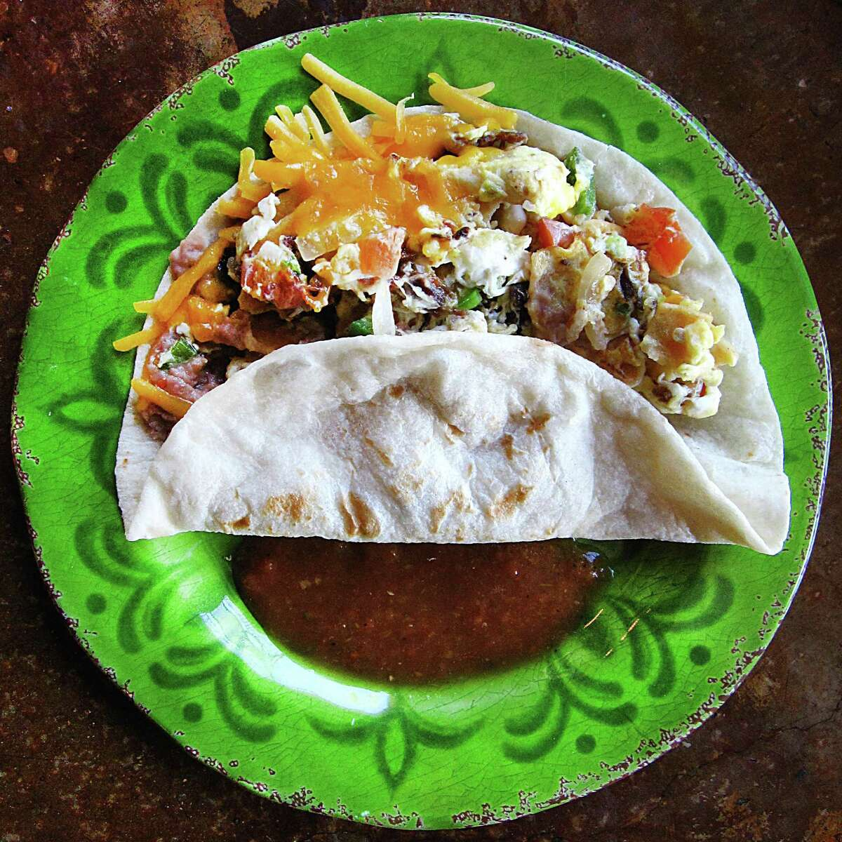 Taco of the Week: Macha Quiles taco with machacado, eggs, beans, chilaquiles and cheese on a handmade flour tortilla from Sazón Mexican Cafe.
