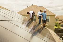 Workers from Alba Solar install solar panels on a home on Upland Sprint Terrace, Katy Texas, June 21, 2017. ( David A. Funchess / Houston Chronicle )