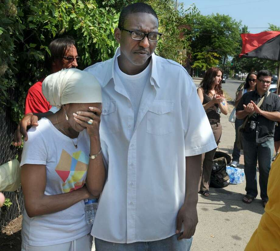 A march and rally in New Haven were held commemorating Malik Jones' birthday. Jones was shot and killed by East Haven police 15 years ago. His mother Emma left was overcome with emotion as she spoke with gratitude about the younger people like Jewu Richardson of New Haven, right, who did much of the organizing work associated with the march. Mara Lavitt/New Haven Register