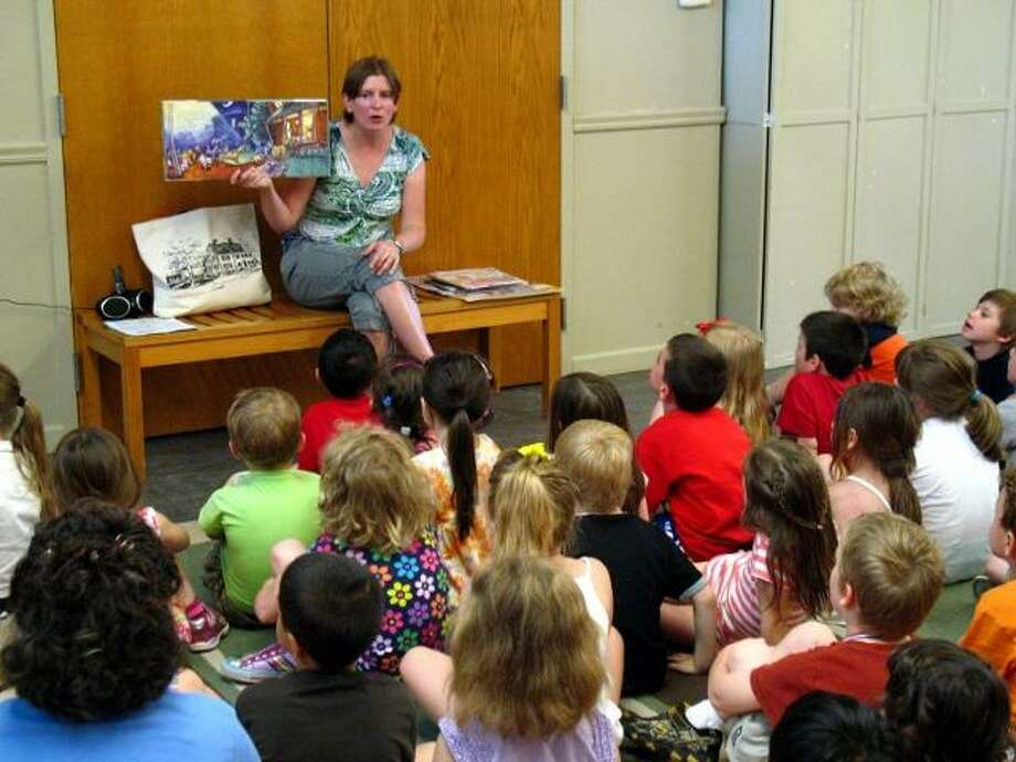 Children's librarian Lisa Shaia reads to Litchfield kindergarteners. Shaia's four years at the Oliver Wolcott Library have been marked with increased outreach to children and high program attendance.  Photo courtesy of Oliver Wolcott Library.
