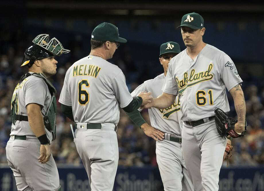 Oakland Athletics manager Bob Melvin takes pitcher John Axford (61) out of the game after he loads the bases in the seventh inning of a baseball game against the Toronto Blue Jays in Toronto, Monday, July 24, 2017. (Fred Thornhill/The Canadian Press via AP) Photo: Fred Thornhill, Associated Press