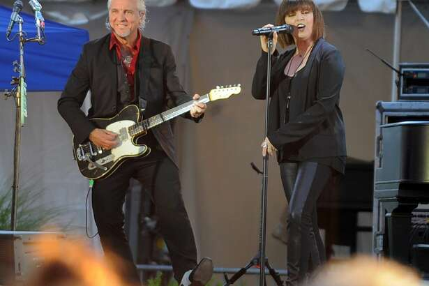 Neil Giraldo and Pat Benatar perform before a near capacity crowd during the Wednesday Nite Live concert series in Columbus Park in Stamford, Conn. on July 27, 2016.