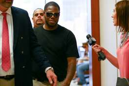 """Houston rapper Joseph Wayne McVey, commonly known by """"Z-Ro,"""" appears at the 351st courtroom of the Harris County Courthouse Thursday, July 27 2017, in Houston. McVey is accused of beating his now ex-girlfriend Brittany Bullock, also known by her rapper stage name """"Just Brittany,"""" while brandishing a handgun in his Katy area home in April."""