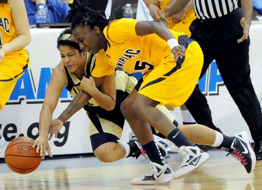 Selina Mann of Mount St. Mary's , left, and Quinnipiac University's Felicia Barron chase a loose ball during the first half of the Northeast Conference Women's Basketball Championship quarterfinals tournament Saturday 3/3/12 at Quinnipiac University's TD Bank North Center in Hamden. Photo by Peter Hvizdak/ New Haven Register Photo: New Haven Register / ©Peter Hvizdak /  New Haven Register