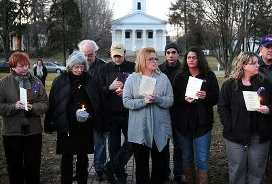 The late Barbara Hamburg's mother, Barbara Lund (second from left), along with family and friends take part in a vigil on the Green in Madison marking the second anniversary of her murder on 3/3/2012.Photo by Arnold Gold/New Haven Register   AG0441E