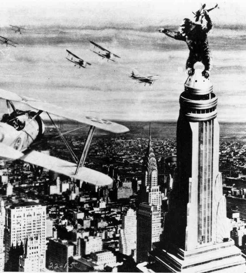 """In this 1933 file photo released by RKO Radio Pictures, King Kong stands atop New York's Empire State Building as he holds an airplane during an attack by fighter planes in a scene from """"King Kong."""" The film was released on this day, March 2, in 1933. (AP Photo/RKO Radio Pictures) Photo: ASSOCIATED PRESS / AP1933"""