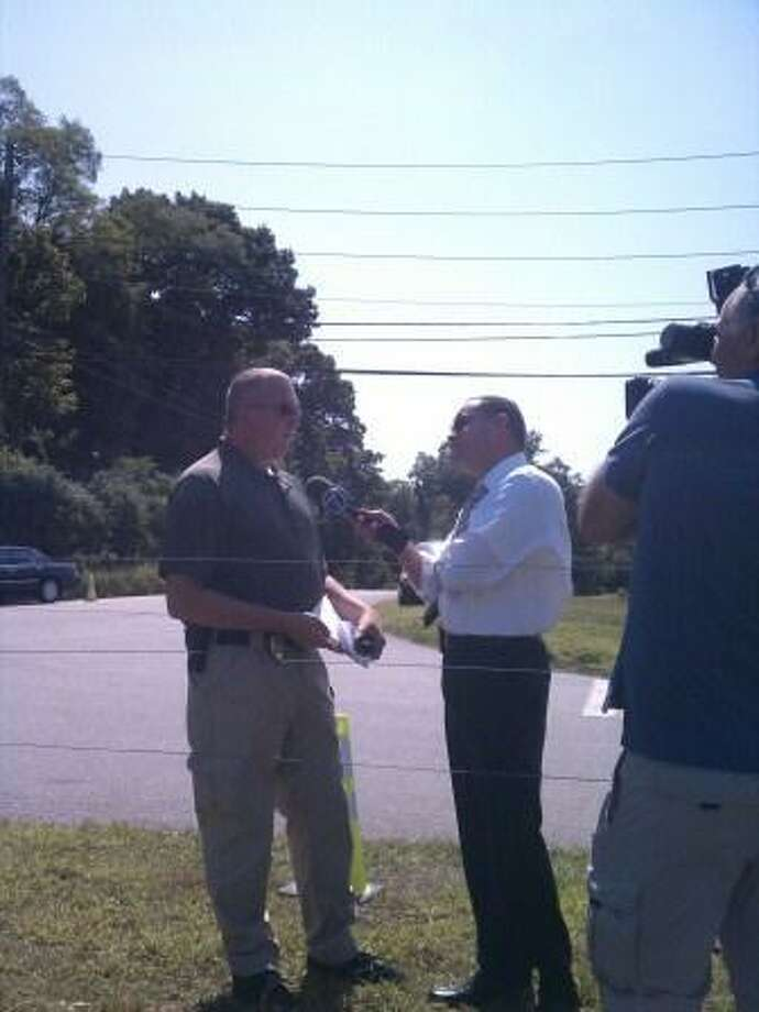 Lt. Lawrence Ash is doing an interview with WTNH News 8 ABC CT. Photo by Douglas P. Clement