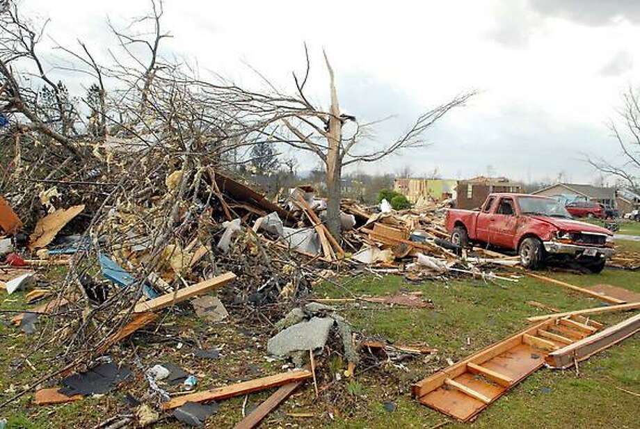 Damage caused by tornadoes are seen near Meridianville, Ala., in Madison County, Friday, March 2, 2012. Powerful storms stretching from the U.S. Gulf Coast to the Great Lakes in the north wrecked two small towns, killed at least three people and bred anxiety across a wide swath of the country in the second deadly tornado outbreak this week. (AP Photo/The Huntsville Times, Dave Dieter) Photo: ASSOCIATED PRESS / AP2012