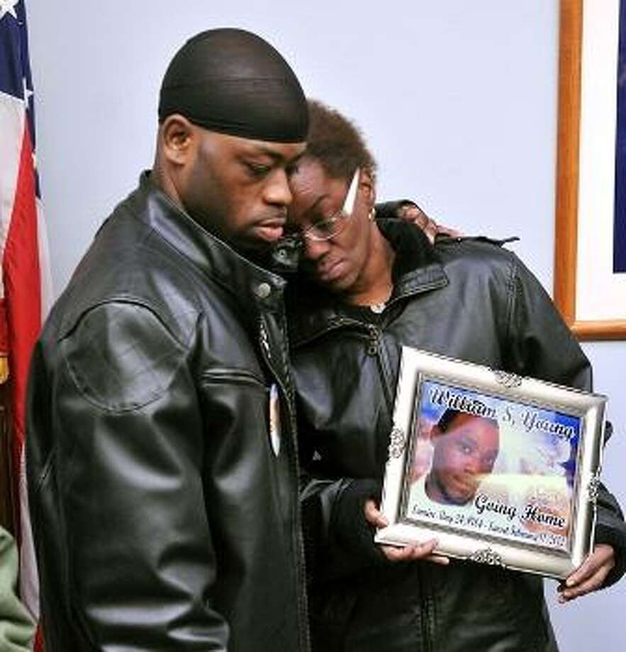 Charlestine Young gets a hug from her son, Shijuan Young, during a press conference asking for help in solving the death of her son, William S. Young. William was found in the Mill River on Feb. 11 and it has been ruled suspicious by police. The press conference was held at the New Haven Police Department. Peter Casolino/New Haven Register