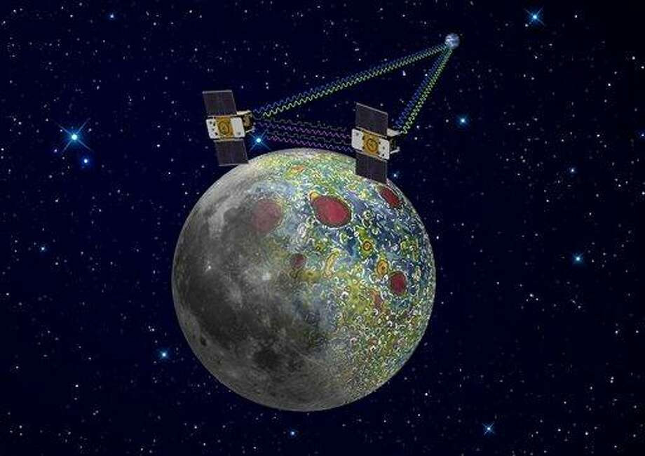 This undated artist rendering provided by NASA on  Dec. 21,2011 shows the twin Grail spacecraft mapping the lunar gravity field. The two probes are scheduled to enter orbit around the moon over New Year's weekend. (AP Photo/NASA, Jet Propulsion Laboratory) Photo: ASSOCIATED PRESS / AP2011