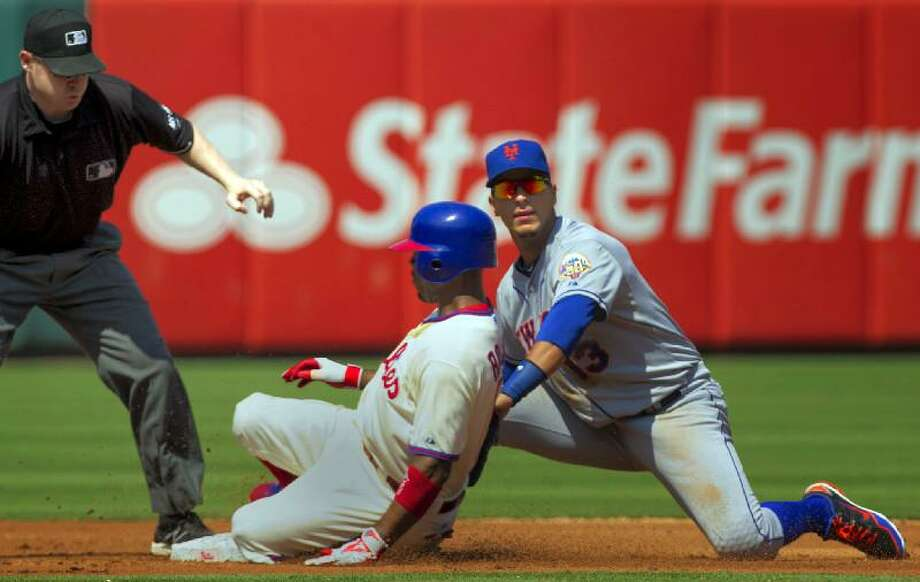 AP Photo/The Philadelphia Inquirer, Ed Hille Philadelphia Phillies' Jimmy Rollins safely slides into second for a double past New York Mets shortstop Ronny Cedeno during the third inning of Thursday's game in Philadelphia. Umpire Mike Estabrook watches at left. The Mets lost 3-2.